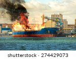 burning cargo ship in the port. | Shutterstock . vector #274429073