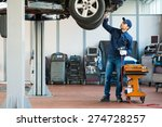 portrait of a mechanic at work... | Shutterstock . vector #274728257