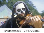 Actor Playing Violin At...