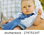 baby on father's hands | Shutterstock . vector #274751147