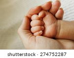 a parent holds the hand of a... | Shutterstock . vector #274752287