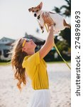 Stock photo young stylish hipster woman holding walking playing dog puppy jack russell tropical park smiling 274898693