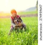 Happy Little Girl With Dog In...
