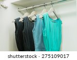 row of colorful dress hanging... | Shutterstock . vector #275109017