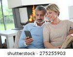 middle aged couple using...   Shutterstock . vector #275255903