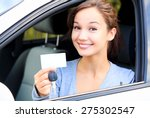 happy girl in a car showing a... | Shutterstock . vector #275302547
