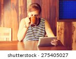 asian woman using tablet... | Shutterstock . vector #275405027