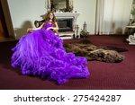 the girl in an elegant purple...   Shutterstock . vector #275424287