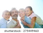 parents giving piggyback ride... | Shutterstock . vector #275449463