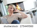 woman listening to music with... | Shutterstock . vector #275449583