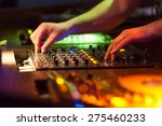 Dj Mixing Music On Console At...