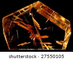 Small photo of Macro of acicular crystals of rutile included in a cut and polished quartz crystal isolated on black
