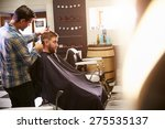 male barber giving client... | Shutterstock . vector #275535137