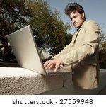 businessman on his laptop   Shutterstock . vector #27559948