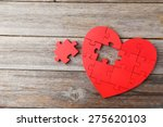 Red Puzzle Heart On Grey Woode...