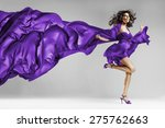 Woman In Violet Waving Dress...