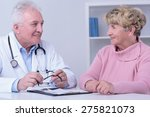 smiling patient and doctor... | Shutterstock . vector #275821073