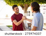 pair of male friends greeting...   Shutterstock . vector #275974337