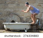 Stock photo fat man in retro swimsuit jumps to the outdoor bathtub funny swimmer in vintage style and bathing 276334883