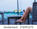 young woman with a glass of... | Shutterstock . vector #276491273