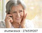 elderly woman calling on phone... | Shutterstock . vector #276539207