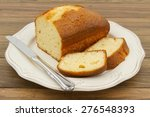 a pound cake and a knife on a... | Shutterstock . vector #276548393