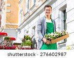 young handsome florist... | Shutterstock . vector #276602987