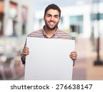 portrait of a young man holding ... | Shutterstock . vector #276638147