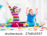 kids playing with wooden toys.... | Shutterstock . vector #276810557