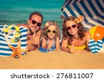 happy family lying on the beach.... | Shutterstock . vector #276811007