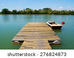Lake  Boat Dock  With Boat And...