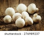White Mushrooms In A Bowl On...