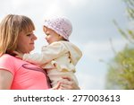 happy woman and child in the... | Shutterstock . vector #277003613