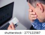 upset man holding credit card...   Shutterstock . vector #277122587