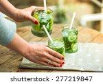 hands holding retro glass jars... | Shutterstock . vector #277219847