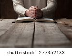 woman hands on bible. she is... | Shutterstock . vector #277352183