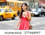 Urban Woman Drinking Coffee...
