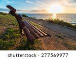 Bench On Sea Coast At Sunset