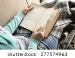 Young Woman Reading Book  Clos...