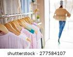 elegant clothes on hangers in... | Shutterstock . vector #277584107