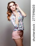 girl in checkered shirt studio...   Shutterstock . vector #277598603