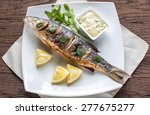 Grilled Sea Bass On The Wooden...