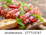 Small photo of Air-dried Italian salami from Tuscany served on a wooden board with ciabatta bread