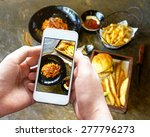 taking photo of food with... | Shutterstock . vector #277796273