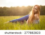 redhead young woman lies on the ... | Shutterstock . vector #277882823