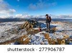 a hiker walking their dog on a... | Shutterstock . vector #277906787
