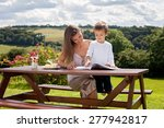 mother and son  reading a book... | Shutterstock . vector #277942817