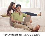 married couple with a laptop | Shutterstock . vector #277961393