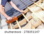 a roofer laying tile on the roof | Shutterstock . vector #278351147