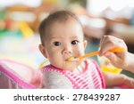 mother feeding her 7 months...   Shutterstock . vector #278439287